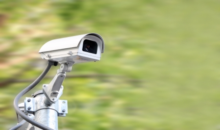 Security camera on blur green plant background Stock Photo - 17158777