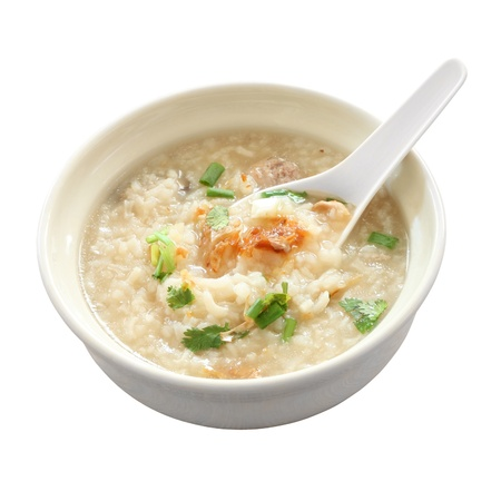 Congee round bowl and spoon on white background. Stock Photo