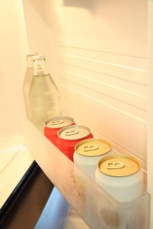 Some beverage in door shelf of refrigerator.
