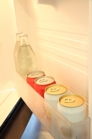 Some beverage in door shelf of refrigerator.