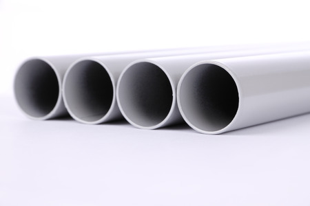 steel pipe: Steel pipes cut front focus on white floor. Stock Photo