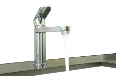 granite counter: Water flow faucet granite counter on white background.