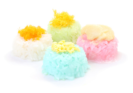 Multiple color of sticky rice with seed custard on white floor.