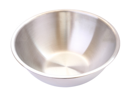 Stainless steel mixing bowl on white background. Stock Photo