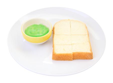 Green pandan custard steamed bread plate on white background. Stock Photo