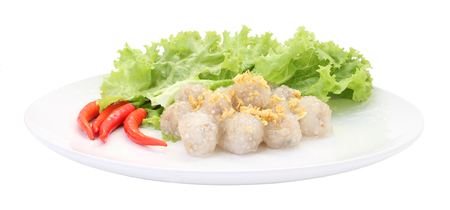 Tapioca balls with pork filling on white dish.