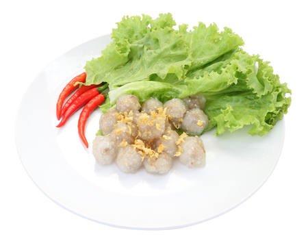 Top of tapioca balls with pork filling on white dish.