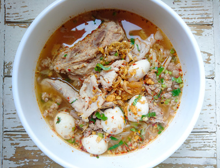 TOM YAM Pork Noodles Soup with Pork Balls, chilly pasted and lime juice  Noodles in Thai spicy tom yum soup with pork