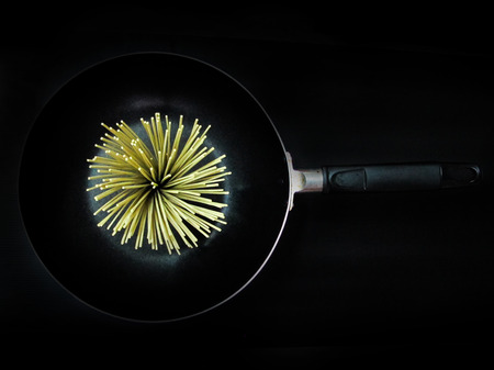 Flower of Noodles in a pan on black background  top view  Фото со стока