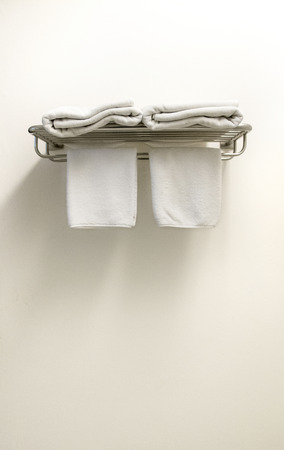 White Terry Towels on hanger in bathroom
