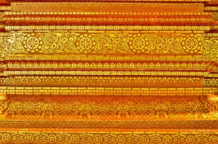 Thai pattern on wood texture in red and gold colour Stock Photo - 18415708