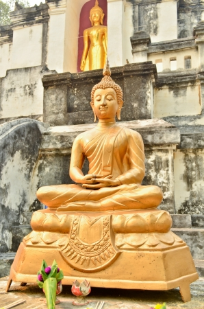 Statue of golden ancient Buddha in Temple THAILAND