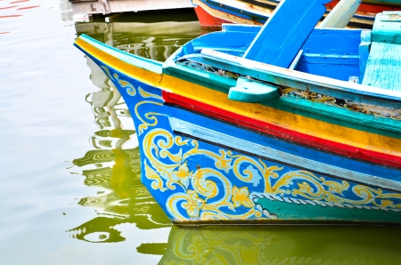 colorful long tail boat in Thailand photo