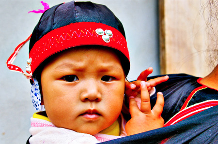 child in Hmong new year festival on January 15, 2013 in Chiang Mai, Thailand