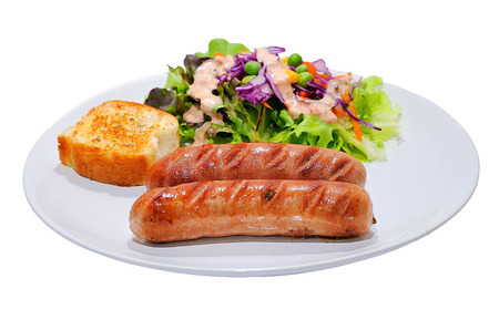 Two smoked sausage against the white  Stock Photo