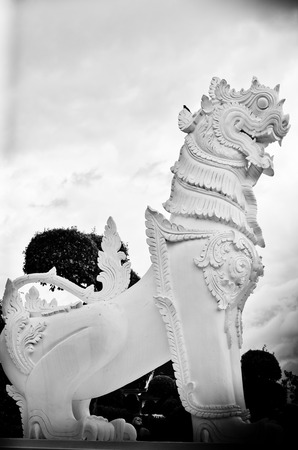 gardian: stone gardian lion at the Buddha Temple, Thailand Stock Photo