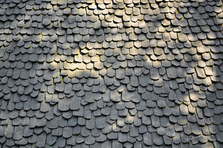 Old wooden roof tiles from north of thailand Stock Photo