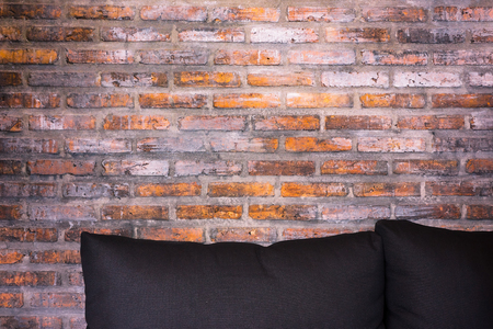 couch: Couch and brick wall - Stock Image Stock Photo