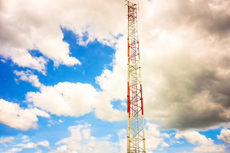 Telecommunication tower and antenna against the sky Stock Photo