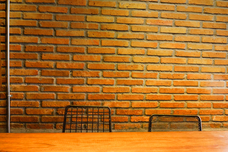 wood counter nightclub with seat chair stool and brick wall background