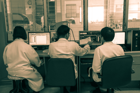 multidisciplinary: CHIANG MAI, THAILAND - JUNE 15, 2016: three experienced physicians in control room,  patient in multidisciplinary Clinic Center Endosurgery