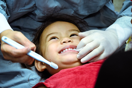 CHIANG MAI, Thailand - April 18, 2016:Doctor dentist teaching a child to brush teeth. Medical Concept. CHIANG MAI, Thailand. Editorial