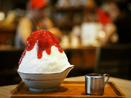 Shaved ice with milk and strawberry jam very Good taste Stock Photo