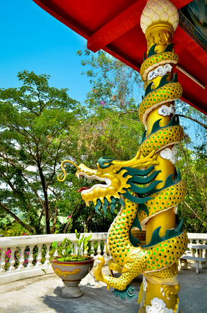 Chinese style dragon statue wrapped around red pole and art Chinese style Stock Photo