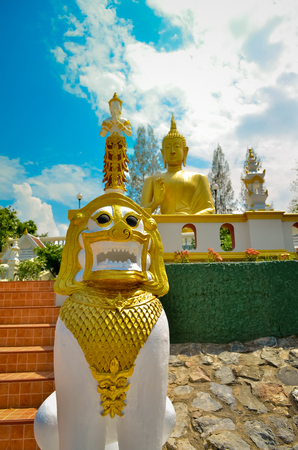 The Thai Lion Statue and golden garuda in Temple of THAILAND