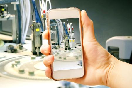centrifuge: Hand holding smart phone (Mobile Phone) with centrifuge. advanced laboratory equipment Stock Photo