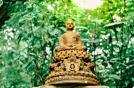 Buddha statue in sunset  in Wat-Umong, Chiang Mai - Thailand