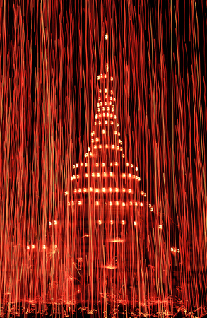Night view of Chedi Pagoda with Fireworks light up the sky. Stock Photo