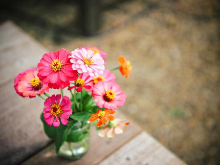 FlowersFlowers wooden background. wooden background. Stock Photo