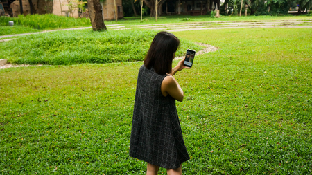 Cute happy woman taking a selfie photo outdoors Stock Photo