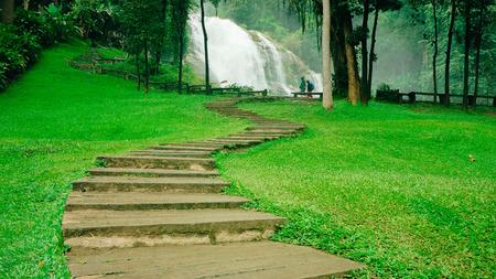 Scenic waterfalls and wooden path - Fall season