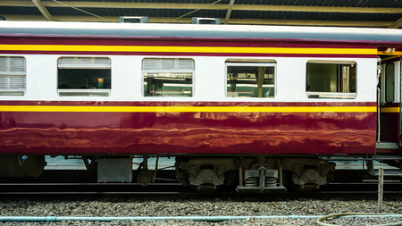 Old diesel train running for reconnect at a platform of railway station Hua Lamphong in Bangkok Editorial