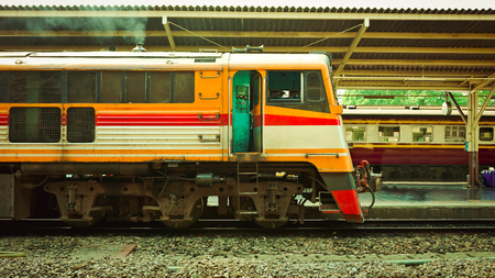 Old diesel train running for reconnect at a platform of railway station Hua Lamphong in Bangkok 스톡 콘텐츠