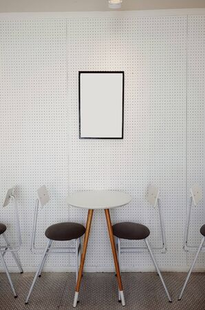 Two chairs and table in bright modern interior Banco de Imagens