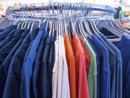casual clothes on a rack in a clothing store photo