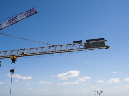 construction crane and a weather station with a blue sky photo