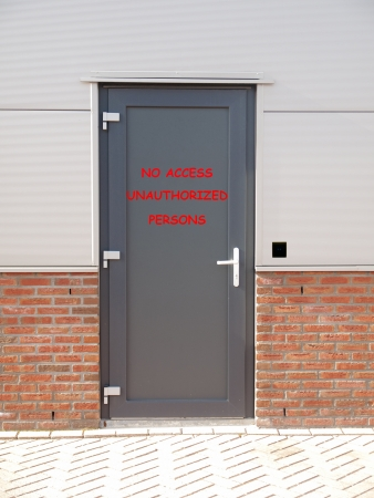 unauthorized: metal door with text no access unauthorized persons and access control system