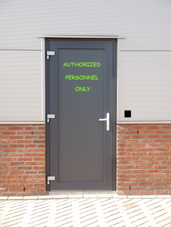 keep gate closed: metal door with text authorized personnel only and access control system