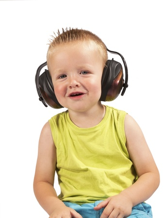 toddler sitting with headphones on his head on a white background Stock Photo - 21706341