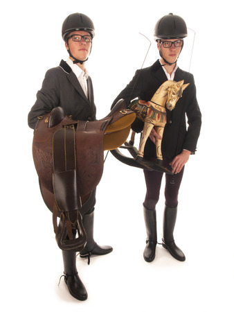 two handsome young men with horses outfit and a rocking horse photo
