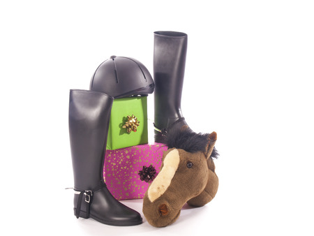 riding boots and gifts with a white background photo