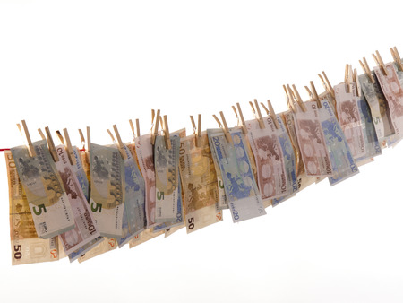 waxes: many euro banknotes on a clothesline