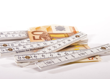 50 euro banknote and carpenters ruler photo
