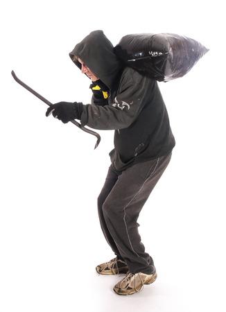 burgler: Suspicious burgler with crowbar
