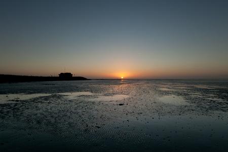 wadden: Sunrise at Wadden Sea wetland on Ameland