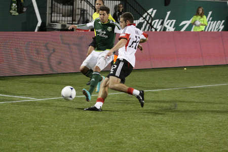 wallace: Lewis Neal ,DC United and Rodney Wallace  ,Portland Timbers both fight for the ball.